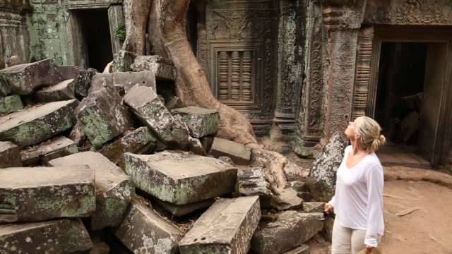 woman walks through ancient ruins, in awe - old ruin stock videos & royalty-free footage