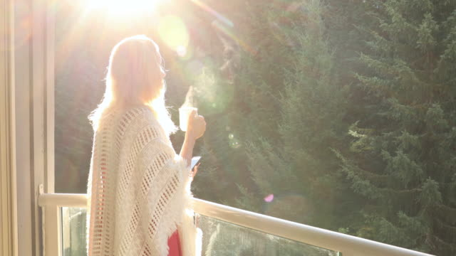 woman walks through doorway to enjoy forest view - shawl stock videos & royalty-free footage