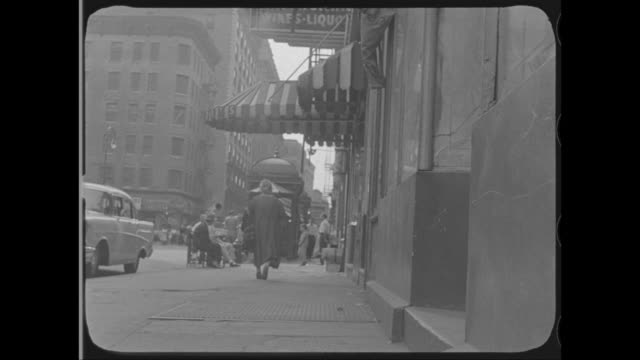 1958 - woman walks toward subway entrance on spring st, new york, ny - around the fair n.y stock videos & royalty-free footage