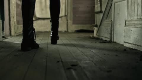 stockvideo's en b-roll-footage met woman walks towards stairs in old building. - veiligheidshek
