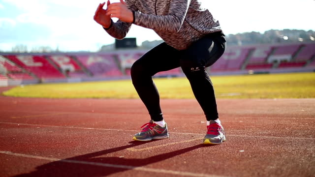 woman warming up jumping - warming up stock videos & royalty-free footage