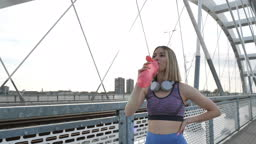 Woman warming up, stretching and jogging outdoors