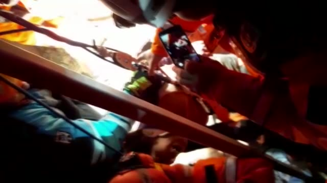 woman was rescued alive from the rubble of a building destroyed in friday's earthquake in elazig, eastern turkey on january 26, 2020. the trapped... - friday stock videos & royalty-free footage