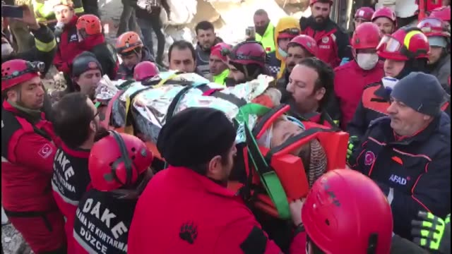 woman was rescued on january 25, 2020 from the rubble of a collapsed house 17 hours after a powerful earthquake hit eastern turkey. the live... - rubble stock-videos und b-roll-filmmaterial