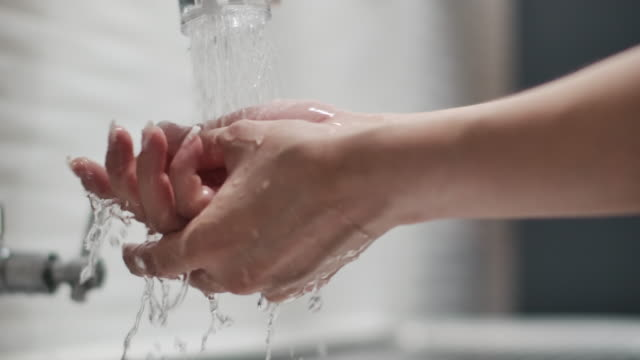 woman wash her hands with alcohol, slow motion - domestic bathroom stock videos & royalty-free footage