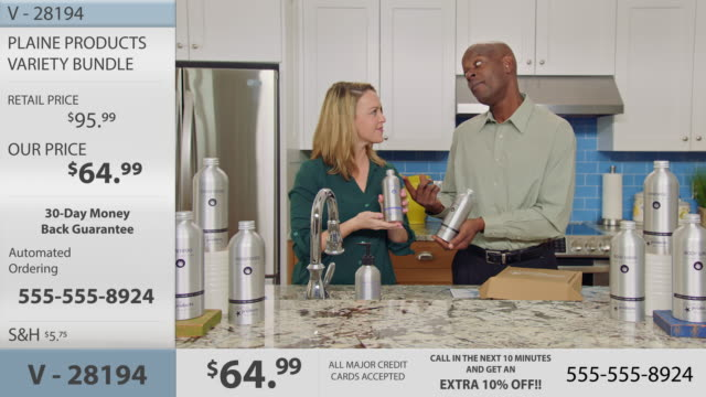 Woman washes hands with scented hand soap and discusses her favorite product with cohost in modern infomercial.