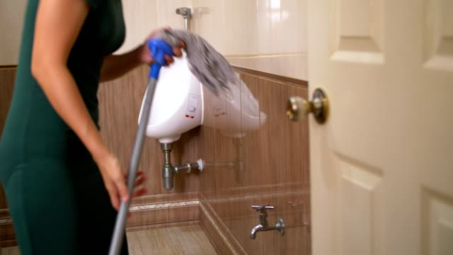 woman washing and squeezing rag - utility room stock videos and b-roll footage