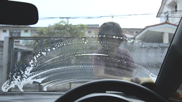 woman washing car - laundry detergent stock videos and b-roll footage