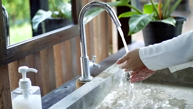 woman washing hands in outdoor cafe - infectious disease stock videos & royalty-free footage