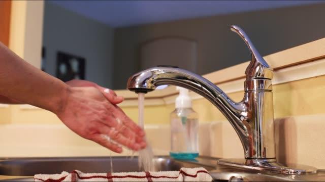 woman washing hands in sink - strofinare lavare video stock e b–roll