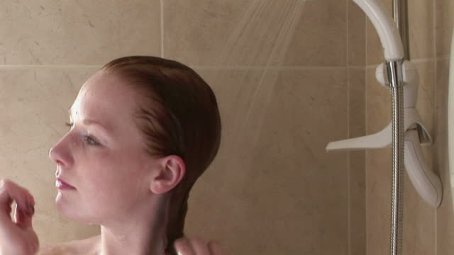 cu woman washing her hair in shower / kinsale, ireland - redhead stock videos & royalty-free footage
