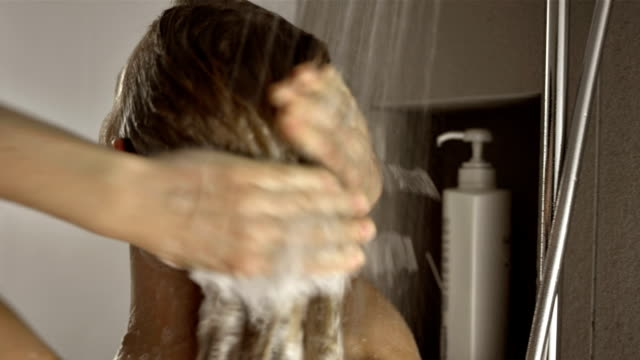 cu woman washing her hair - washing hair stock videos & royalty-free footage