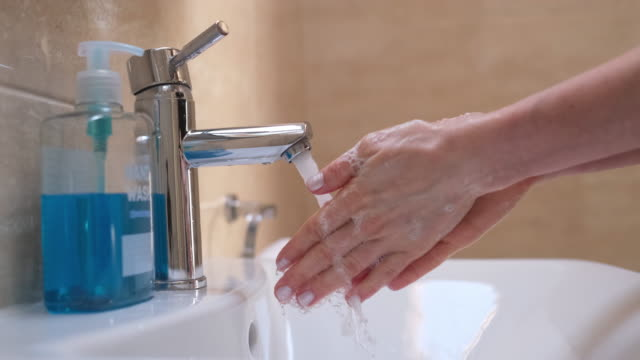 woman washing her hands - lava video stock e b–roll