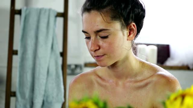 Woman washing neck