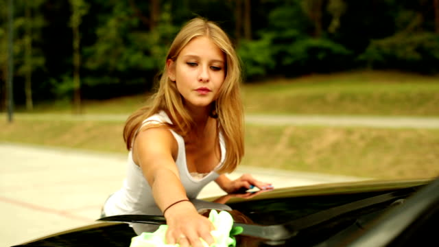 Woman washing the car.