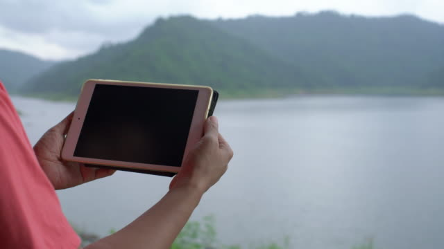 woman watch digital tablet at dam - e reader stock videos & royalty-free footage