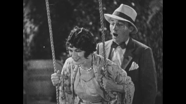 1932 A woman watches a man (Bing Crosby) sing to her impersonator