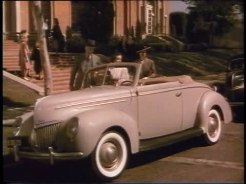 1939 woman watches as man presents new convertible ford to teen girl - 1939 stock videos and b-roll footage