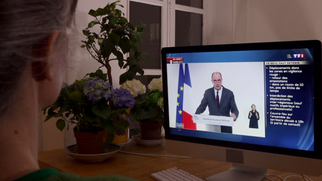 woman watches jean castex press conference on thursday evening at 7 p.m. on march 04 in paris, france. the main government announcements are:... - 45 49 years stock videos & royalty-free footage