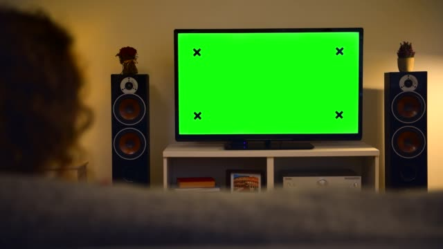 woman watching chroma key green screen tv at home - living room stock videos & royalty-free footage