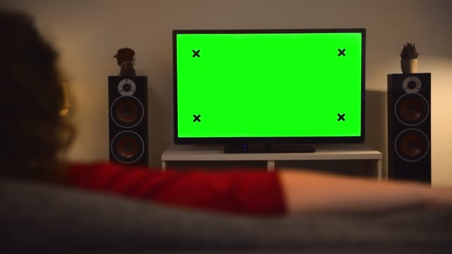 woman watching chroma key green screen tv at home - watching tv stock videos & royalty-free footage