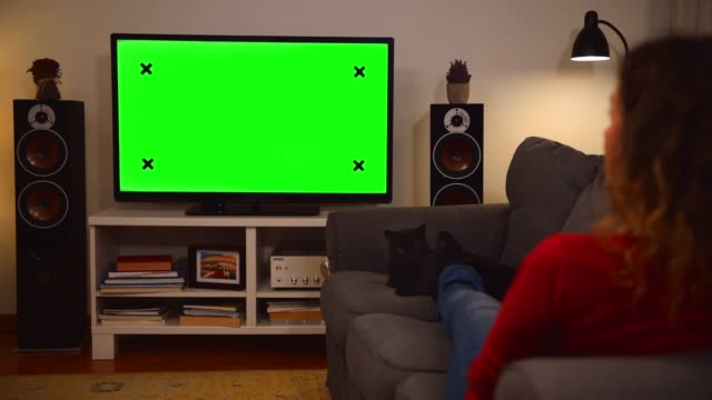 woman watching chroma key green screen tv at home - remote control stock videos & royalty-free footage