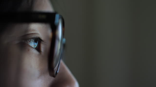 woman watching screen, reflection in glasses - intelligence stock videos & royalty-free footage