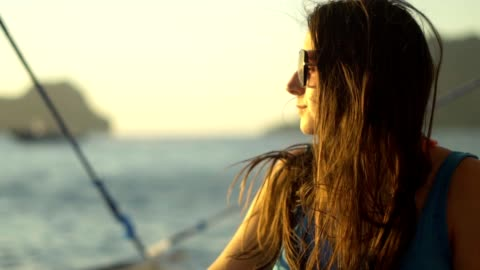 woman watching sunset on a sailboat - small boat stock videos & royalty-free footage