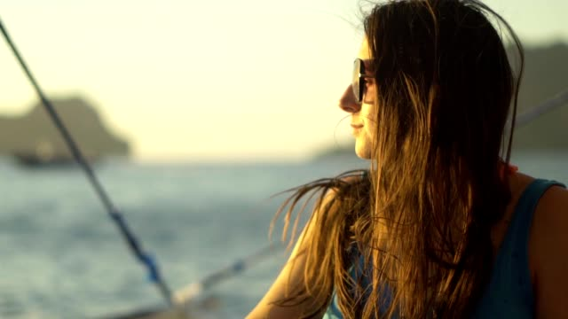 woman watching sunset on a sailboat - sailing boat stock videos & royalty-free footage