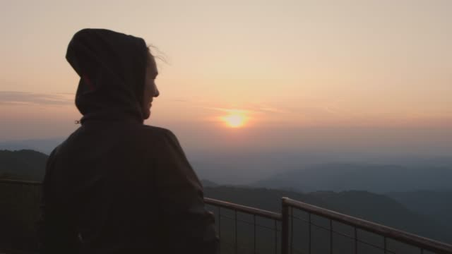 woman watching sunset on the viewpoint - observation point stock videos & royalty-free footage