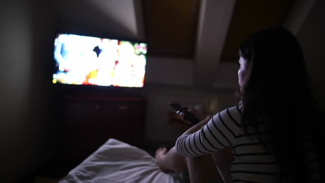 woman watching tv at night. - television show stock videos & royalty-free footage