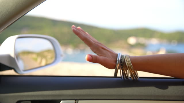 ms woman waves her hand in the summer breeze - waving hands stock videos & royalty-free footage