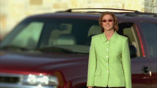 ms pan slo mo woman waving and walks toward house / johnson city, texas, usa - johnson city texas stock videos & royalty-free footage