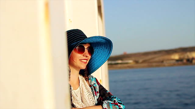 woman waving from boat - malta stock videos & royalty-free footage