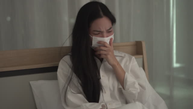 woman wear mask and cough with fever - ward stock videos & royalty-free footage
