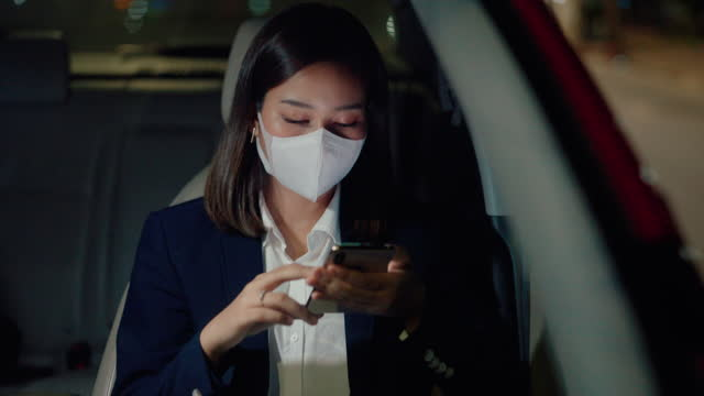 woman wear medical mask while commuting at night. - car interior stock videos & royalty-free footage