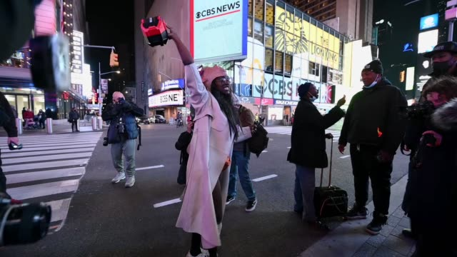 woman wearing a donald trump mask on her head dances as people await election results on election day 2020 in times square on november 03, 2020 in... - joe 03 stock videos & royalty-free footage