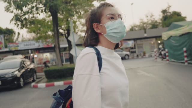 woman wearing a face mask at the grocery store. - car park stock videos & royalty-free footage