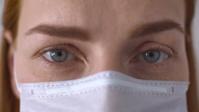woman wearing a protective face mask - avian flu virus stock videos & royalty-free footage