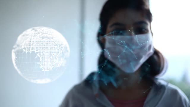 woman wearing a protective mask with conceptual representation of digital numbers information flow - protection stock videos & royalty-free footage
