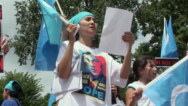 Woman wearing Barack Obama 'hope' tshirt and leading slogans among protestors during an antiChina protest outside the White House in support of the...