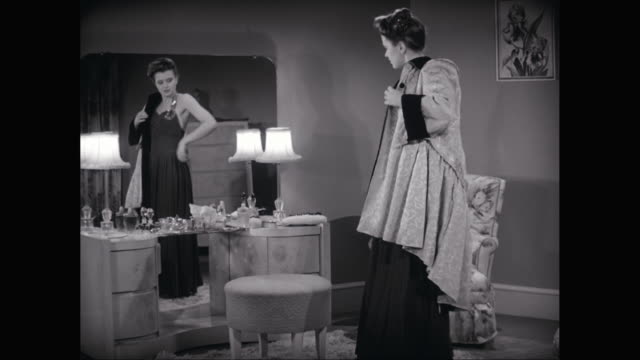 ms zo woman wearing coat and smiling in her dressing room / united states - evening gown stock videos and b-roll footage