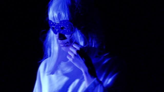 ms woman wearing eye mask standing in studio - light blue stock videos & royalty-free footage
