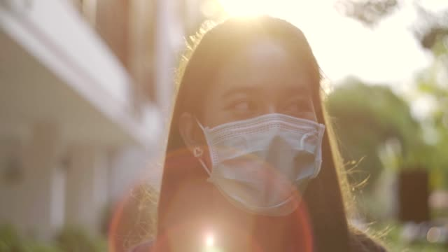 woman wearing face mask and walking to work. - outdoors stock videos & royalty-free footage