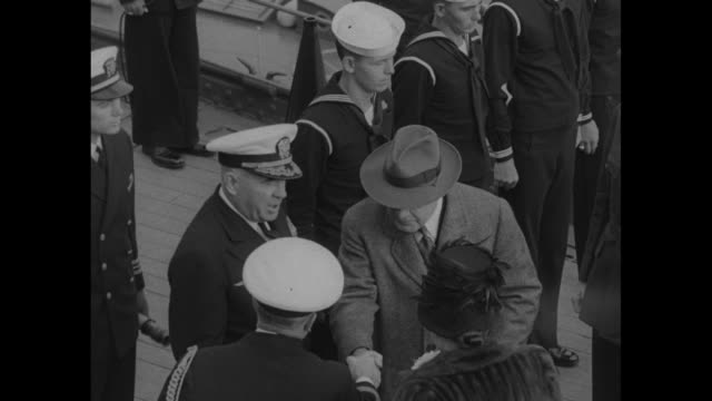 woman wearing fur coat and orchid corsage walking up steps and boarding carrier uss franklin d roosevelt then shaking hands with ship's captain vice... - sheep meadow central park stock videos and b-roll footage
