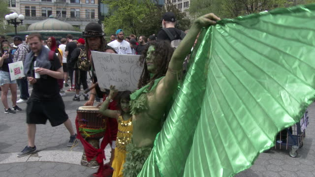 A woman wearing green body paint and adorning a cape joins hundreds of others at the Cannabis Day Rally in Union Square Park New York The rally is in...