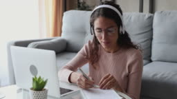Woman wearing headphones distance learning conference calling working from home
