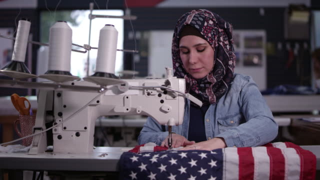 woman wearing headscarf sewing american flag - sewing stock videos & royalty-free footage