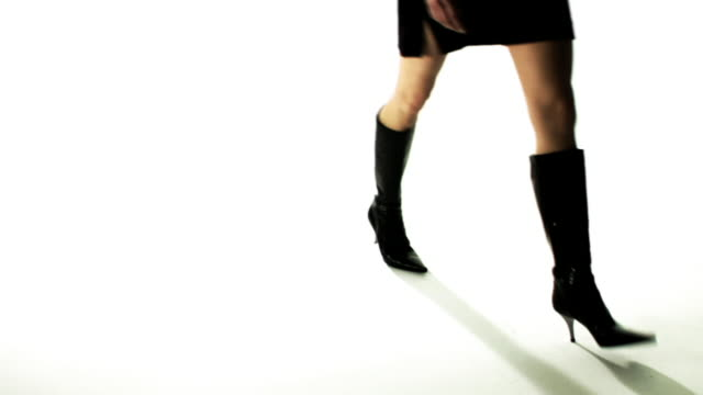slo mo, cu, woman wearing high heeled boots and mini skirt walking in studio, low section - mini skirt stock videos and b-roll footage