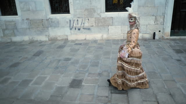 woman wearing historical clothing and carnival mask walking in old town - historical clothing stock videos & royalty-free footage